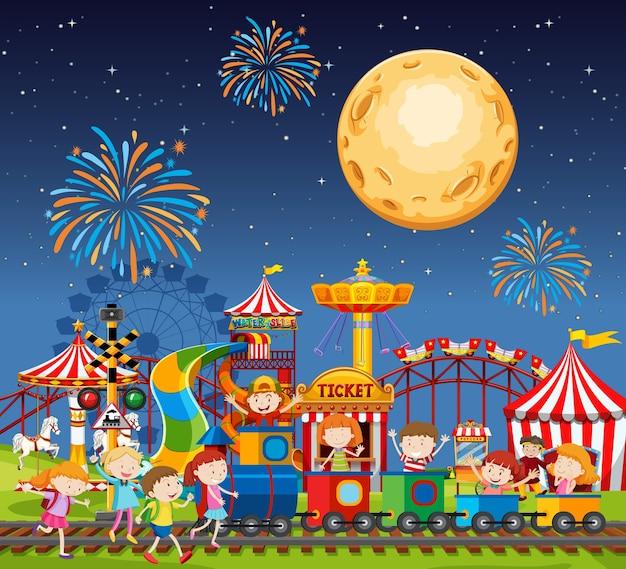 Escena del parque de atracciones en la noche con fuegos artificiales y luna en el cielo vector gratuito