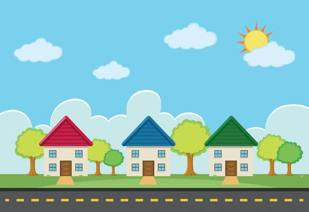 Escena con tres casas a lo largo de la carretera vector gratuito