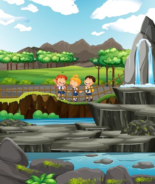 Escena con tres niños en la cascada. vector gratuito