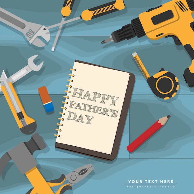 La escritura del día de padres feliz del texto en el cuaderno pone en el escritorio de madera del mecánico azul con las herramientas amarillas de la reparación casera Vector Premium