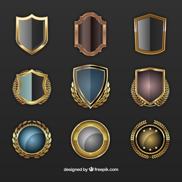 Escudos de oro vector gratuito