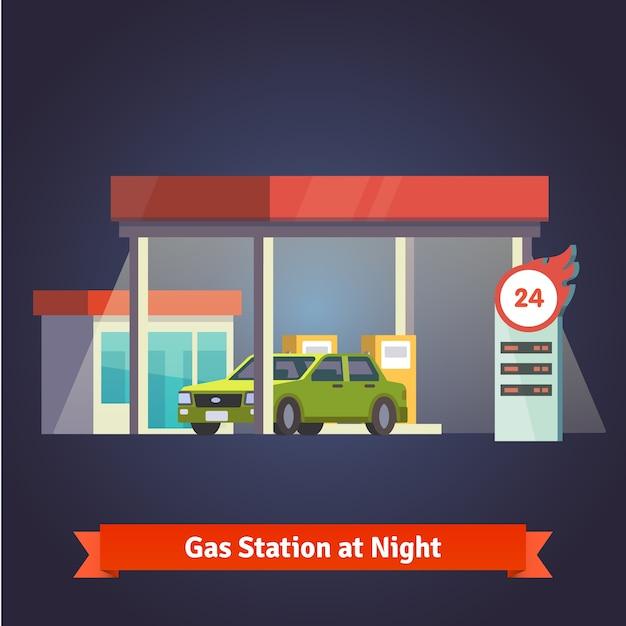 Estación de gasolina que brilla intensamente en la noche. Tienda, tabla de precios Vector Gratis