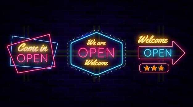 Estamos abiertos conjunto de letrero de neón vector gratuito
