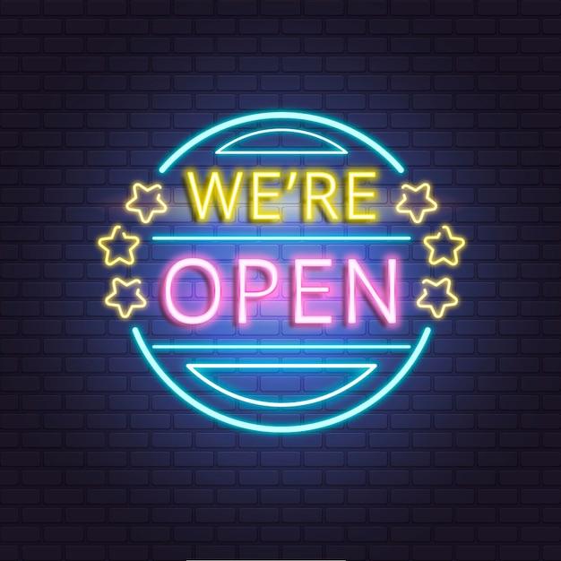 'estamos abiertos' letrero de neón en la pared de ladrillo vector gratuito