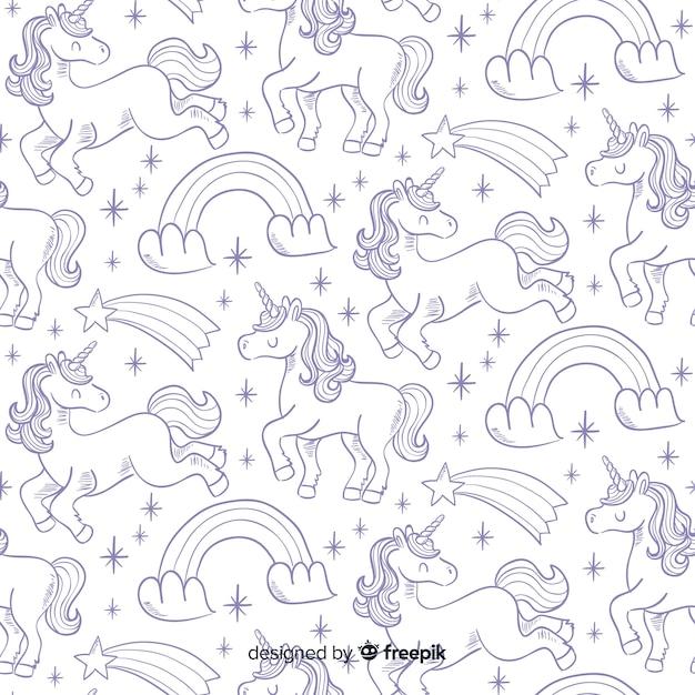 Estampado de unicornios dibujado a mano vector gratuito