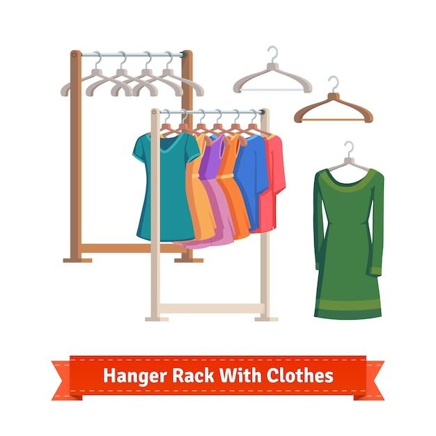 Estante de ropa con vestidos en perchas vector gratuito