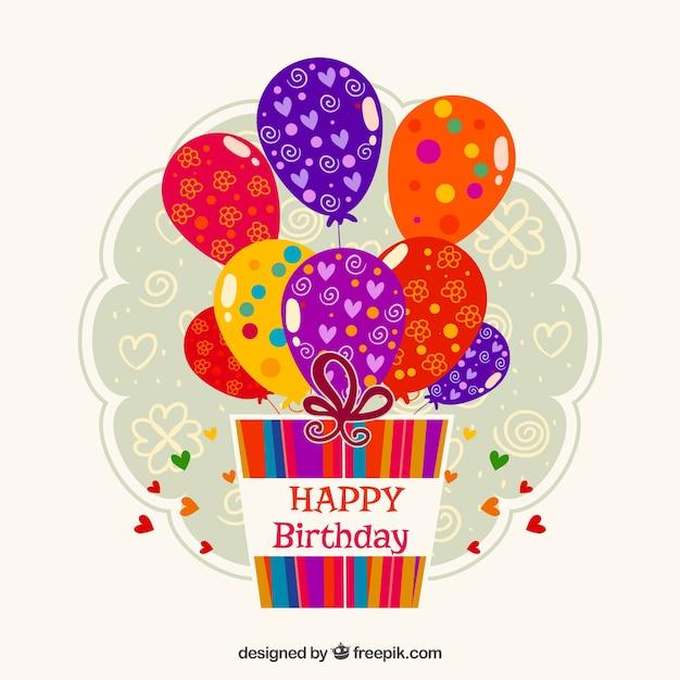 Etiqueta de cumpleaños con regalos y globos vector gratuito