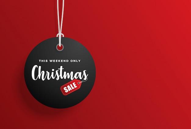 Etiqueta de venta de navidad con fondo rojo Vector Premium
