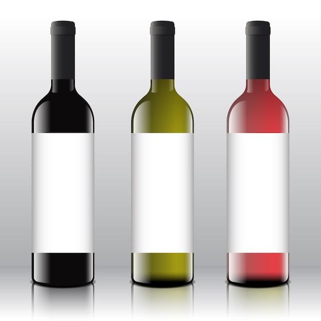 Etiquetas en blanco de vino tinto, blanco y rosado de primera calidad en las botellas realistas. vector gratuito