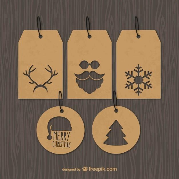 Etiquetas de la Navidad vintage Vector Gratis