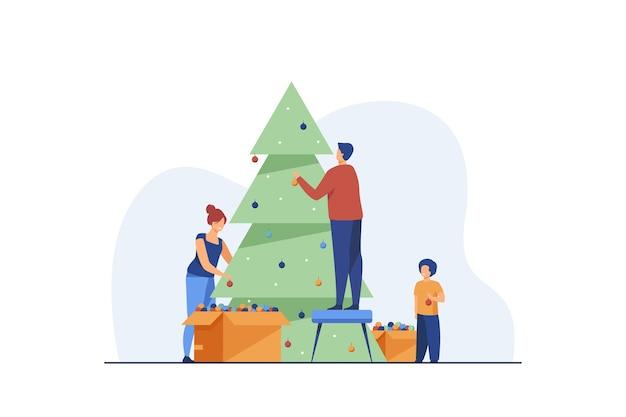 Familia decorando el árbol de navidad juntos. vector gratuito