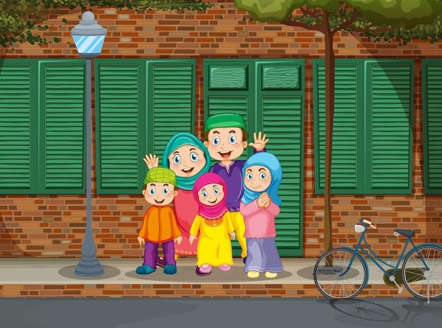 Familia musulmana de pie junto a la carretera. vector gratuito