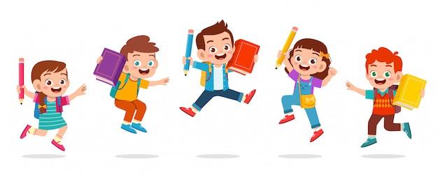 Felices los niños lindos niño y niña saltan Vector Premium