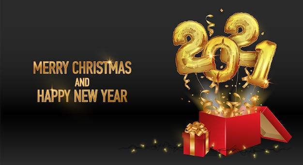 Feliz año nuevo y navidad 2021. números de globos dorados 2021. Vector Premium