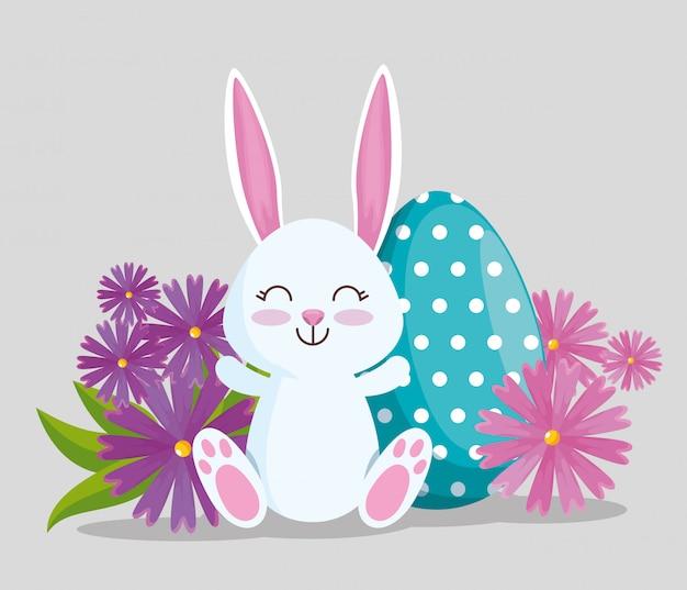 Feliz conejo con decoración de poitas de huevo vector gratuito