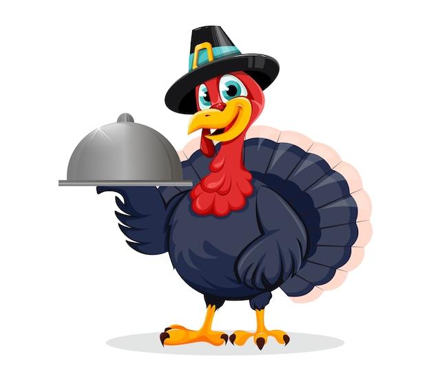 Feliz día de acción de gracias. divertido pájaro pavo con bandeja abovedada Vector Premium