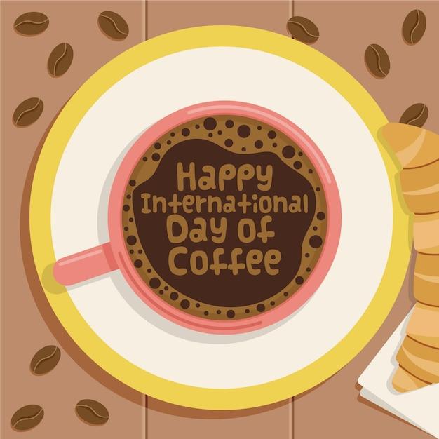 Feliz día internacional del café en taza con croissant vector gratuito
