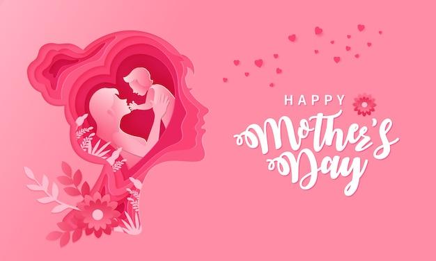 Feliz día de la madre. ilustración de la tarjeta de felicitación de la madre y el bebé dentro de papel cortado silueta de cabeza de mujer Vector Premium