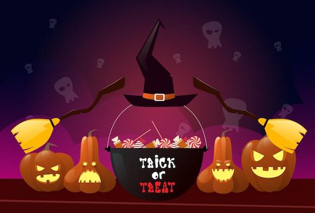 Feliz halloween con calabazas y escoba de bruja y maceta Vector Premium