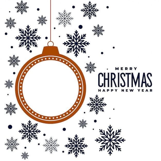 Feliz navidad copos de nieve y bola de fondo vector gratuito