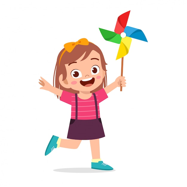 Feliz niño lindo niña sonrisa con juguete Vector Premium