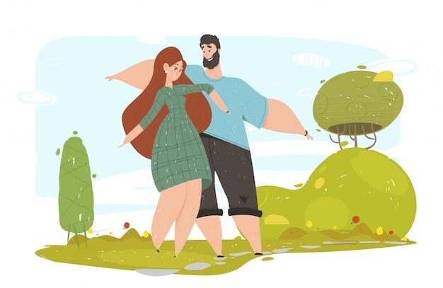 Feliz pareja amorosa agitando las manos caminando en el parque Vector Premium