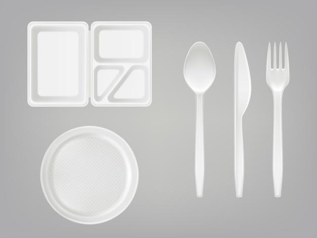 Fiambrera de plástico desechable realista con partición, plato, cubiertos - cuchara, tenedor, cuchillo Vector Premium