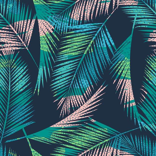 Sin fisuras patrón exótico con plantas tropicales. Vector Premium