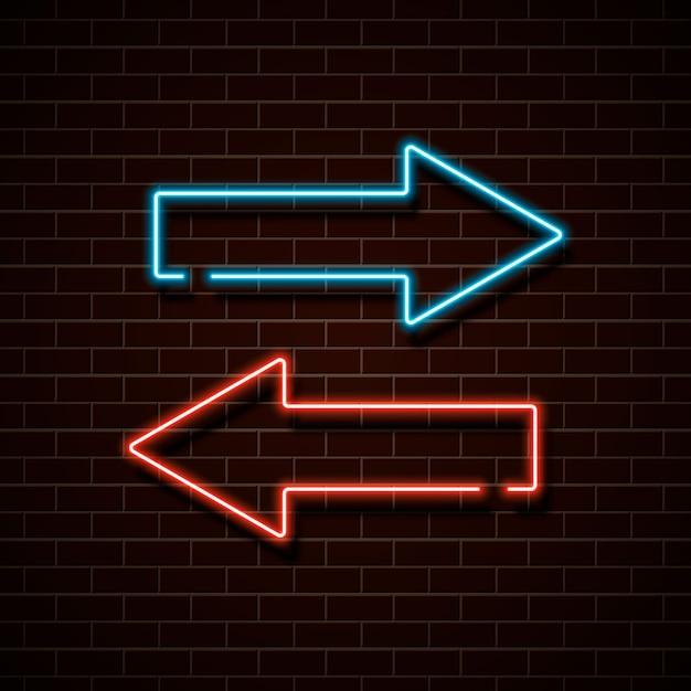 Flechas rojas y azules de neón en una pared de ladrillo. Vector Premium