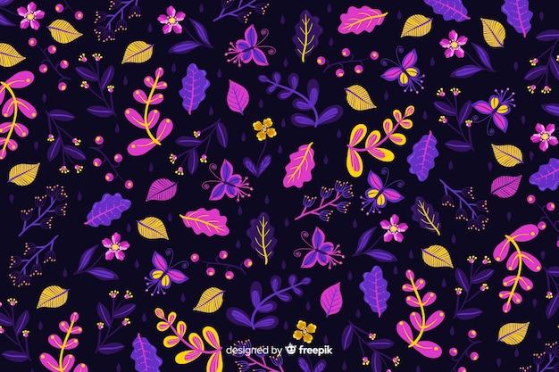 Flores de colores sobre fondo oscuro vector gratuito