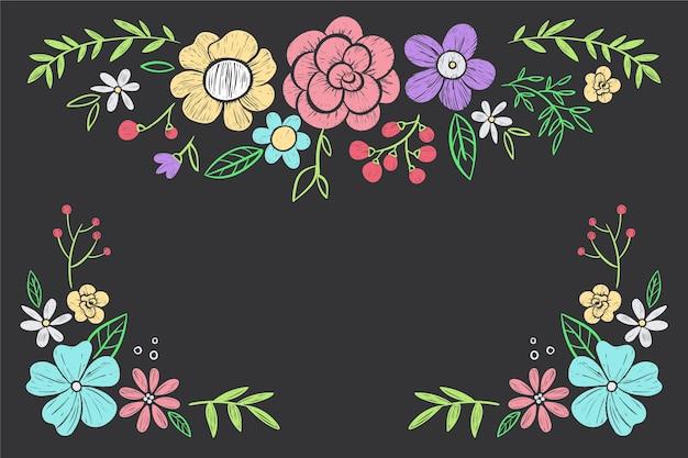 Flores dibujadas a mano sobre fondo de pizarra vector gratuito