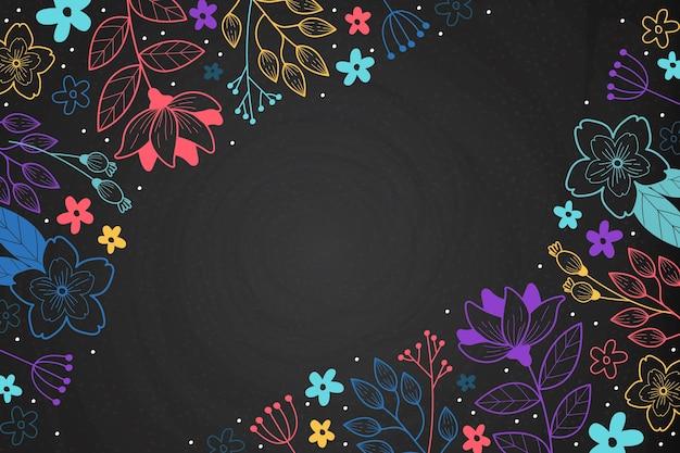 Flores dibujadas a mano sobre fondo de pizarra Vector Premium