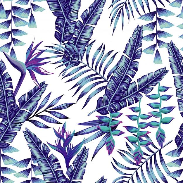 Flores tropicales azules y hojas de palma de patrones sin fisuras Vector Premium