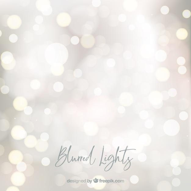 Fondo abstracto de luces borrosos Vector Premium