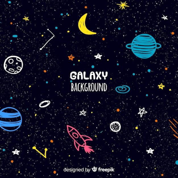 Fondo adorable de galaxia dibujado a mano Vector Premium