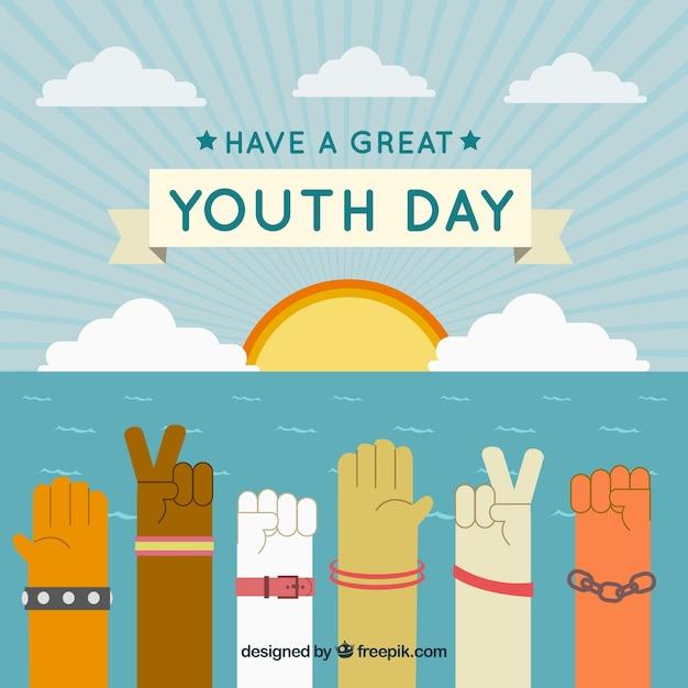 Fondo de atardecer con manos celebrando el día de la juventud vector gratuito
