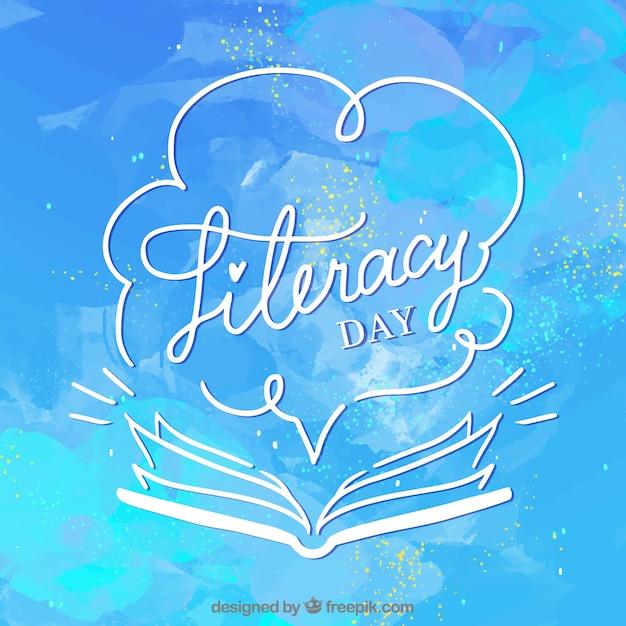 Fondo azul de acuarela del día de la alfabetización con libro abierto vector gratuito