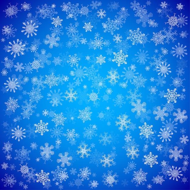 Fondo azul de navidad con diferentes copos de nieve Vector Premium