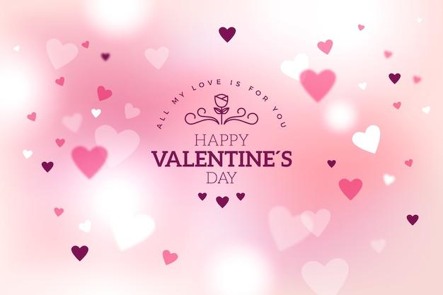 Fondo borroso rosa de san valentín con corazones vector gratuito