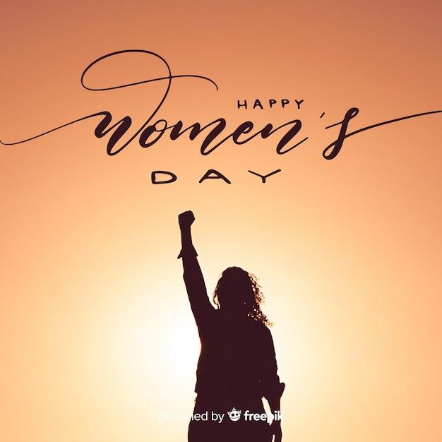 Fondo caligráfico del día de la mujer vector gratuito
