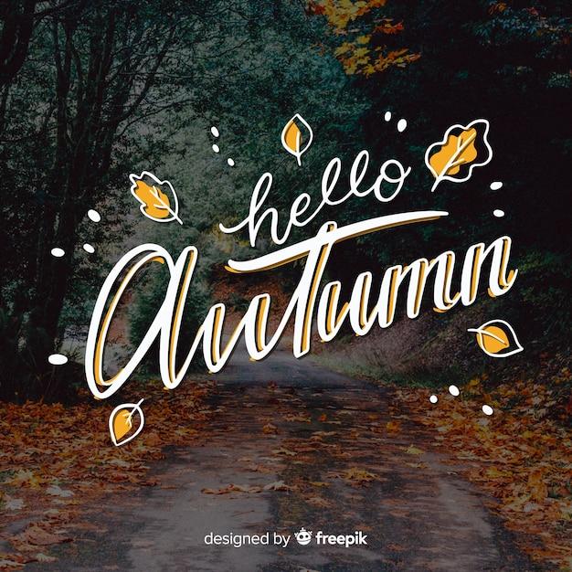 Fondo caligráfico de hello autumn con foto vector gratuito