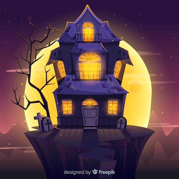Fondo con casa encantada de halloween con luces difuminadas vector gratuito