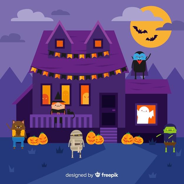 Fondo de casa de halloween con personajes encantados vector gratuito