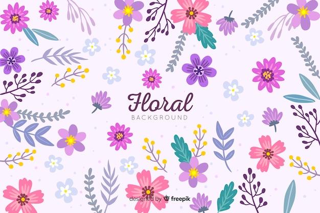 Fondo colorido de flores dibujado a mano vector gratuito