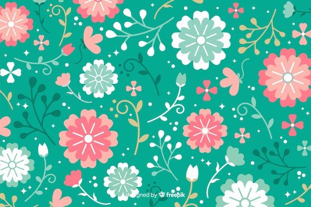 Fondo colorido de flores en diseño plano vector gratuito