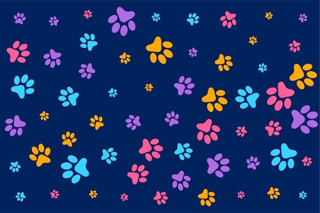 Fondo colorido de huellas de perro o gato vector gratuito