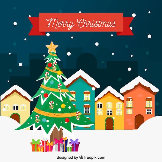Fondo de casas nevadas y rbol de navidad Descargar Vectores gratis
