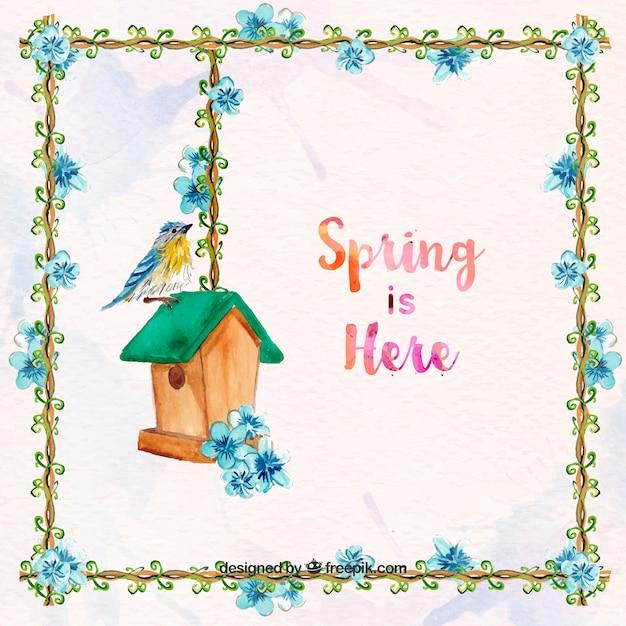 Fondo de primavera con marco floral y pájaro con casita de madera Vector Gratis