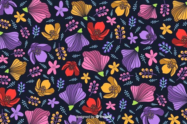 Fondo decorativo de flores de colores planos vector gratuito