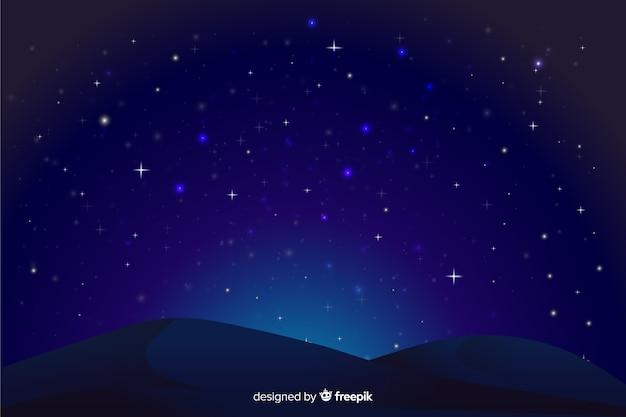 Fondo degradado de noche estrellada y formas de montaña vector gratuito